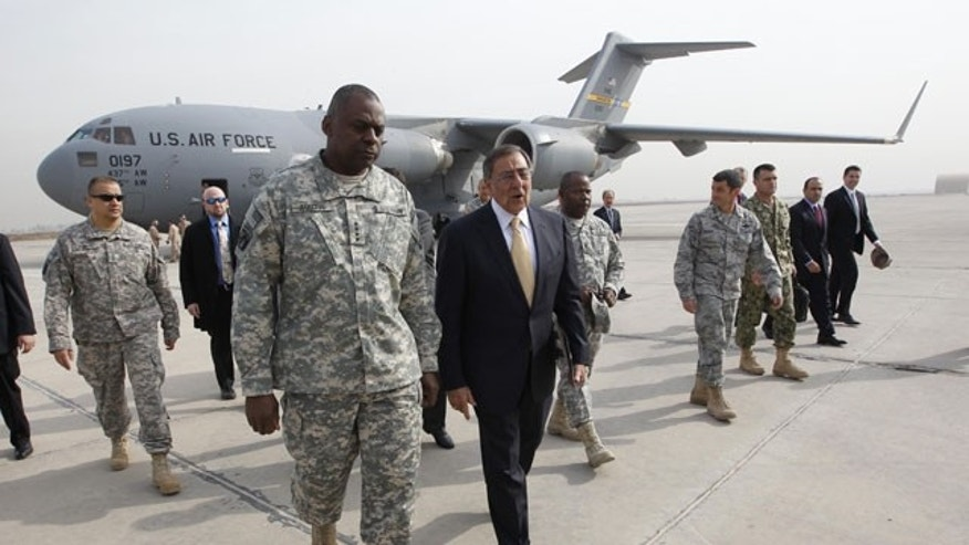 December 15, 2011: U.S. Sec. of Defense Leon Panetta, right, walks across tarmac with Army Gen. Lloyd Austin, left, Commander of U.S. Forces Iraq, during his arrival at Baghdad, Iraq.