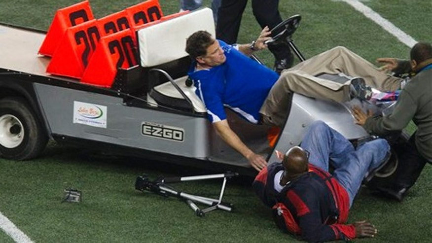 December 17, 2011: Spring Dekaney head coach Willie Amendola is upended as an out of control cart runs several bystanders over on the Cowboys Stadium field after Spring Dekaney defeated Cibolo Steele 34-14 during the Class 5A Divison II state championships high school football game.