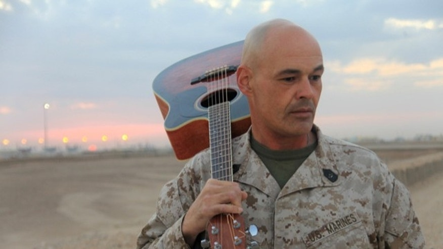 USMC Master Sgt. Robert Allen seen here with his guitar at Camp Leatherneck, Afghanistan where he is currently stationed.