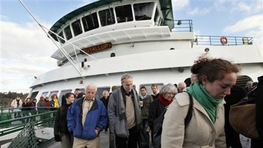 Dec. 21, 2011: Passengers disembark from the Washington state ferry Puyallup on its arrival on Bainbridge Island, Wash.
