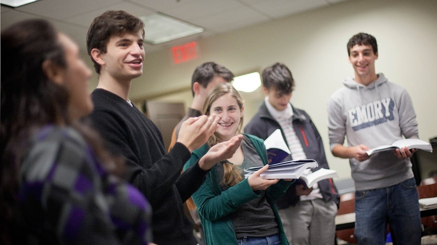 November 10: Matthew Birnbaum, 19, left, leads a class in singing a song during a Yiddish class at Emory University in Atlanta.