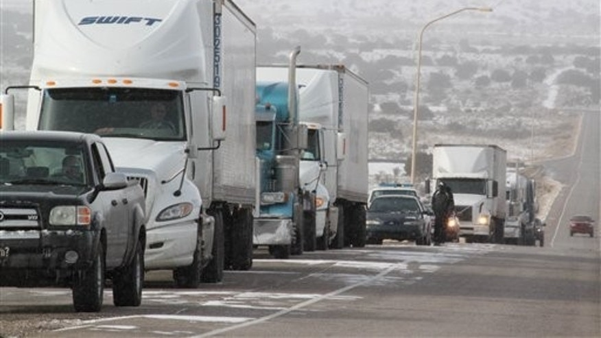 Dec. 23: Dozens of vehicles sit along the side of a highway in Rio Rancho, N.M., waiting for authorities to reopen U.S. 550 northbound.