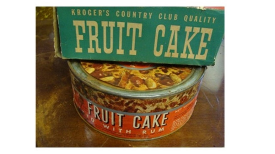This photo provided by Elite Estate Group, shows a fruitcake made in 1941 by The Kroger Co. It was returned unopened to a Kroger store in 1971.