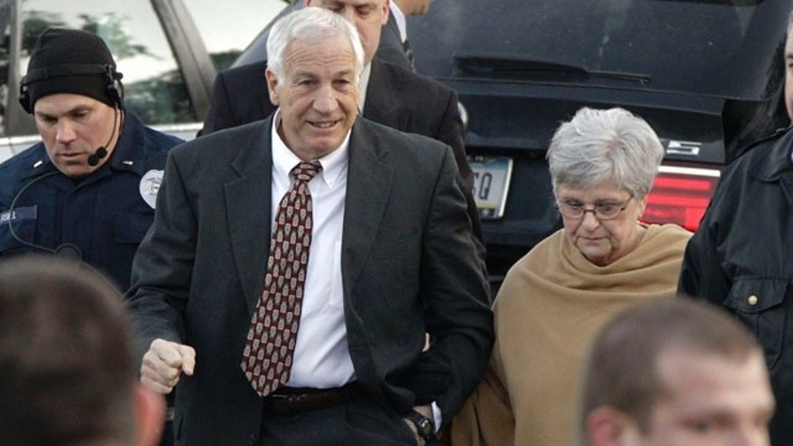 Dec. 13, 2011: Jerry Sandusky, left, the former Penn State assistant football coach charged with sexually abusing boys, arrives with his wife, Dottie Sandusky, for a preliminary hearing at the Centre County Courthouse in Bellefonte, Pa., where he will face his accusers.