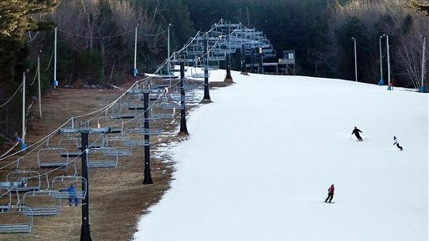 Jan. 5: Man-made snow coats a ski run but barren ground remains under a chairlift at Shawnee Peak ski area, in Bridgton, Maine.