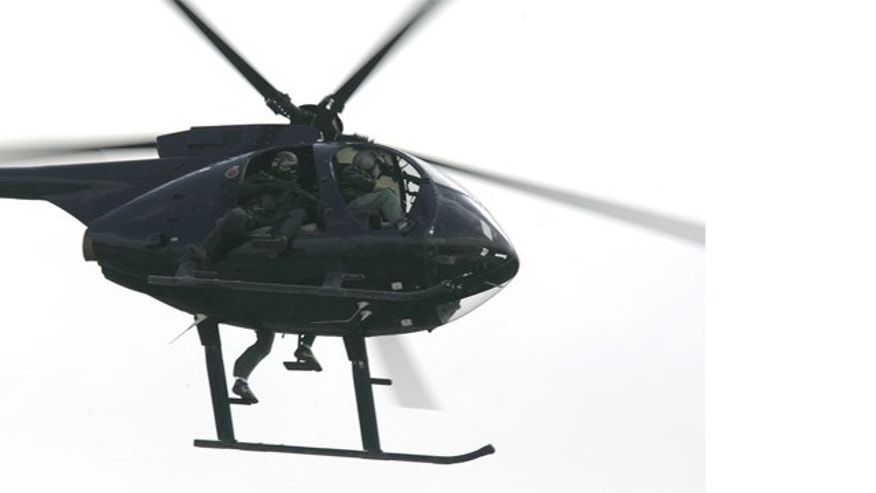 FILE 2007: Blackwater USA helicopter flies over central Baghdad.
