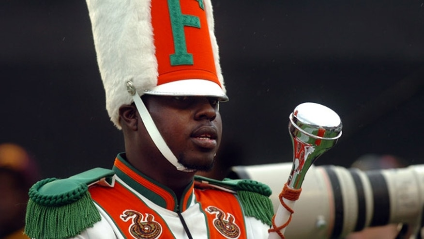 Nov. 19, 2011: Robert Champion, a drum major in Florida A&M University's Marching 100 band, performs during halftime of a football game in Orlando, Fla.