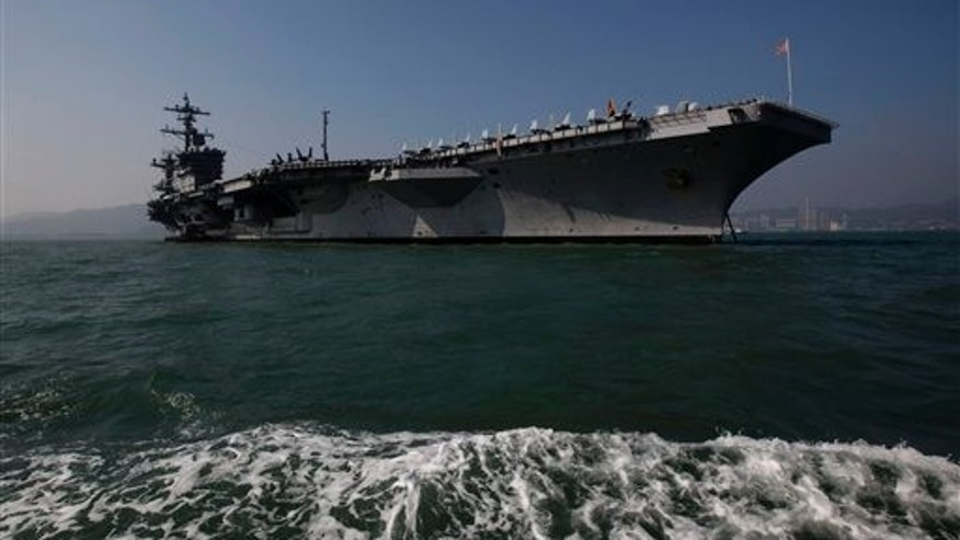 Dec. 27, 2011: The aircraft carrier USS Carl Vinson is anchored in Hong Kong water on its way to the Arabian Sea.