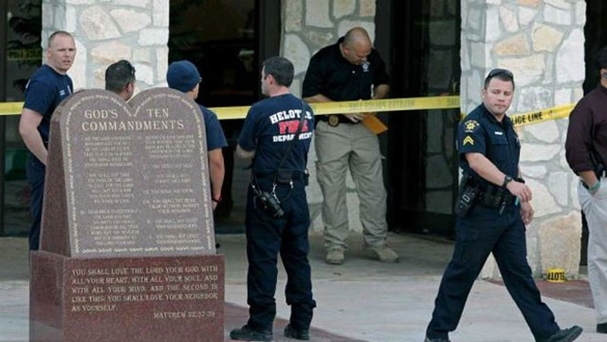 January 12, 2012: Law enforcement officials gather at the scene of a double shooting at Our Lady of Guadalupe Catholic Church in Helotes, Texas.
