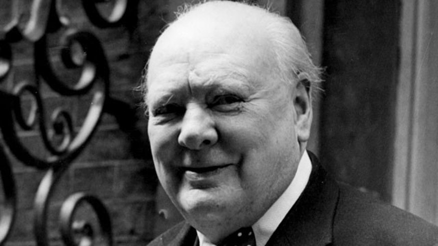 In this June 24, 1952, file photo, Sir Winston Churchill smiles at the front door of 10 Downing Street, London.