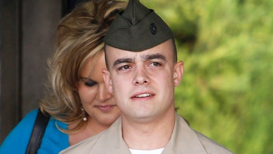 FILE - In this March 22, 2010 file photo, Marine Corps Staff Sgt. Frank Wuterich arrives for a pretrial hearing at Camp Pendleton Marine Corps Base in San Diego County, Calif.