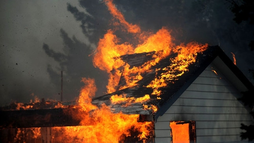 January 19, 2012: A house burns just south of the Old 395 Gas Station in Washoe Valley, Nev. Winds gusting up to 82 mph pushed a fast-moving brush fire south of Reno out of control on Thursday as it burned several homes, threatened dozens more and forced more than 4,000 people to evacuate their neighborhoods.