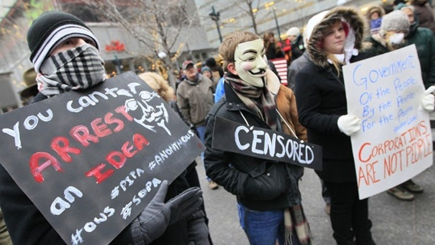 January 20, 2012: Members of Occupy Cincinnati rally on Fountain Square before marching to the Potter Stewart United States Courthouse in Cincinnati.