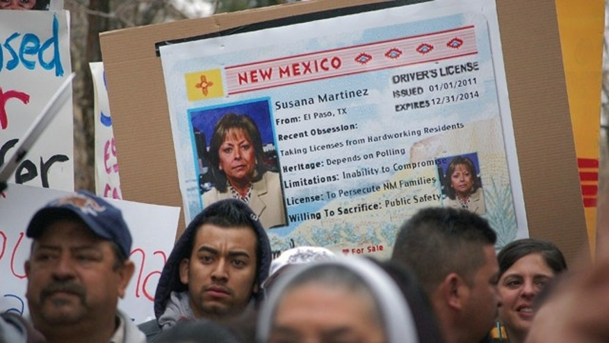 Jan. 24, 2012: Immigrant advocates use an image of New Mexico Gov. Susana Martinez on a mock state driver's license during a rally in Santa Fe to protest her proposal to repeal a state law that allows illegal immigrants to obtain driver's licenses.