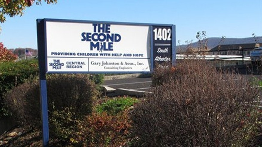 November 2, 2011: A sign for The Second Mile charity is seen outside the organization's headquarters in State College, Pa.