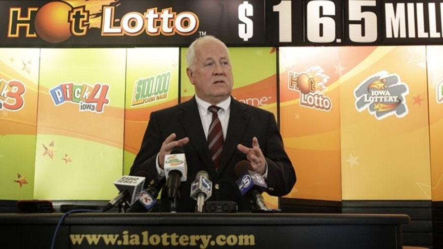 January 23, 2012: Iowa Lottery CEO Terry Rich speaks during a news conference at the Iowa Lottery headquarters in Des Moines, Iowa. The Iowa Lottery is warning that it will deny payment of a mysterious jackpot claim if the New York lawyer who made it doesn't provide key details by Friday.