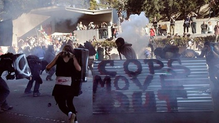 January 28, 2012: Oakland police deploy smoke and tear gas to stop protesters with the Occupy Oakland as they march through the streets of downtown Oakland, Calif.