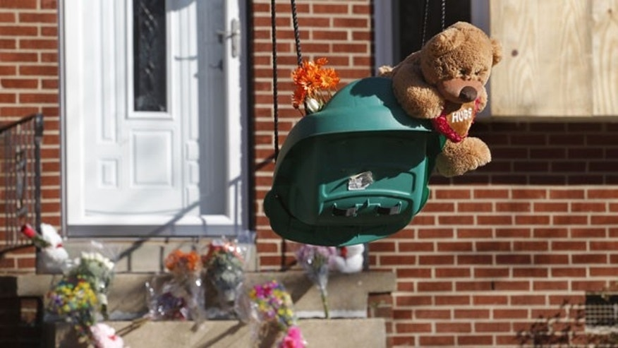 January 29, 2012: A makeshift memorial appears at the house where the Hanover Sheriff's Office found three bodies inside Saturday in Mechanicsville, Va., near Lee-Davis High School.