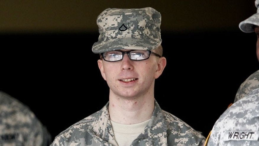 In this file photo taken Dec. 22, 2011, Army Pfc. Bradley Manning is escorted from a courthouse in Fort Meade, Md. An Army officer has ordered a court-martial, Friday, Feb. 3, 2012 for Manning, a low-ranking intelligence analyst charged in the biggest leak of classified information in U.S. history.