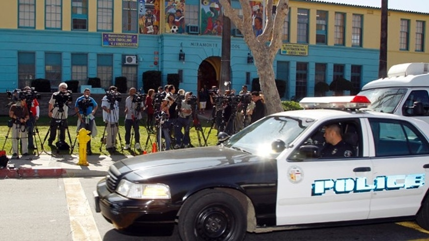 Feb. 3, 2012: Members of the media gather outside the Miramonte Elementary school in Los Angeles.