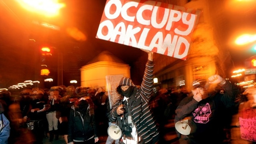 Feb. 4, 2012: Melvin Kelley leads about 75 Occupy Oakland protesters through Oakland, Calif.