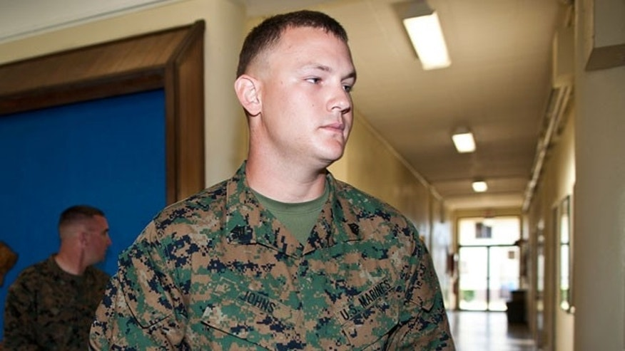 Jan. 30, 2012: Marine Sgt. Benjamin Johns walks to the courtroom of the Legal Services Center of Marine Corps Base Hawaii in Kaneohe Bay, Hawaii. Johns, Lance Cpl. Jacob D. Jacoby, and Lance Cpl. Carlos Orozco III are accused of hazing fellow Marine Lance Cpl. Harry Lew, who later committed suicide.