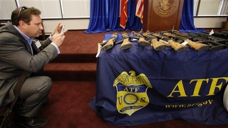 Feb. 8: A reporter photographs seized firearms that were destined for the Los Zetas drug trafficking organization in Mexico are seen at a news conference in San Antonio.