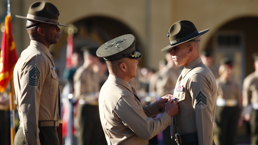 "Feb. 10, 2012: United States Marine Sgt. Philip A. McCulloch Jr., right, receives the Silver Star medal from Brigadier General Daniel D. Yoo for ""conspicuous gallantry and intrepidity in action"" while serving in Afghanistan during a ceremony at the Marine Corp Recruit Depot."