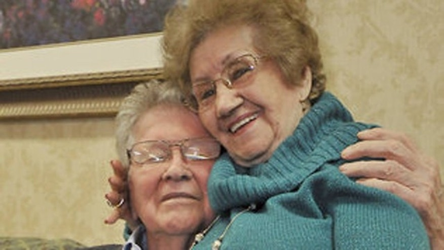 Larry Bushnell, 85, and Columba Rosaly, 97, pictured together at the Sharon Village retirement center in Charlotte, N.C.