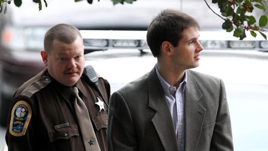 Feb. 14: George Huguely is escorted to court.