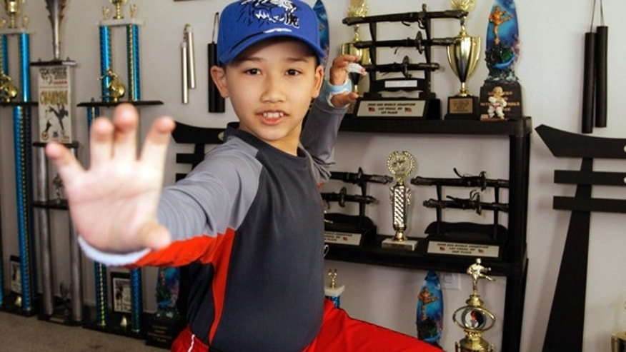 FILE 2008: Moshe Kai Cavalin, 10, strikes a martial arts position at his home studio in Downey, Calif.