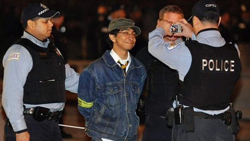 Oct. 23, 2011: In this file photo, a protester is photographed by Chicago police after his arrest at an Occupy Chicago march. Chicago Alderman Ricardo Munoz is expected to introduce on Wednesday an ordinance that would prohibit the city's police department from cutting off access to cell phone networks and social media sites during the G-8 and NATO summits in the city in May 2012.