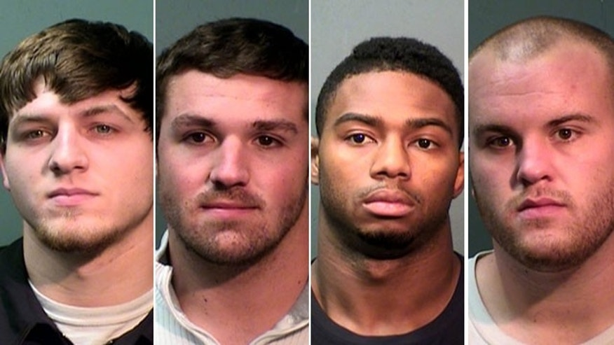 Booking photos provided by the Fort Worth Police Department show TCU football players D.J. Yendrey, Tanner Brock, Devin Johnson and Tyler Horn.