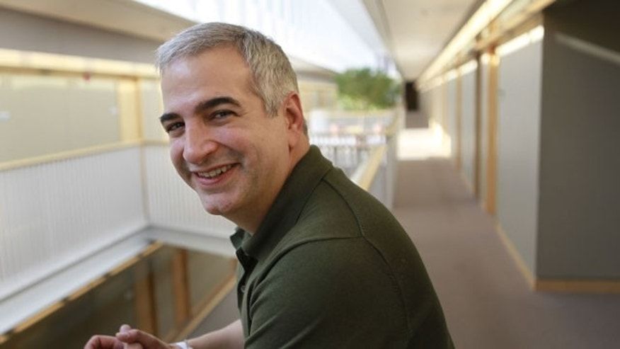 In this April 12, 2010 file photo, Anthony Shadid, winner of the 2010 Pulitzer Prize for International Reporting with The Washington Post, poses for a portrait at the Watson Institute for International Studies, on the campus of Brown University, in Providence, R.I.