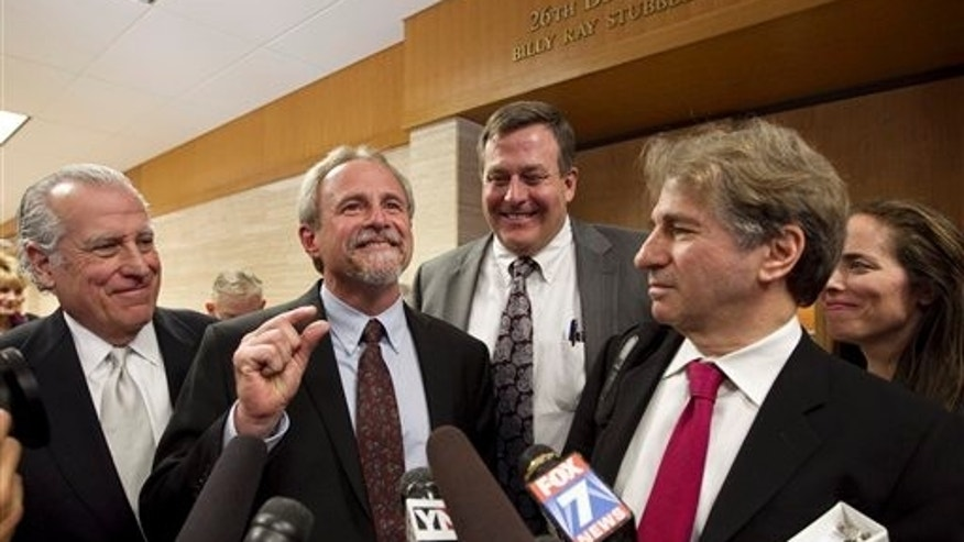 Feb. 10: Michael Morton, second from left, and his legal team, left to right, Gerald Goldstein, John Raley, Barry Scheck and Nina Morrison speak to the media after Judge Sid Harle ruled in favor of a court of inquiry fpr Judge Ken Anderson at the Williamson County Justice Center in Georgetown, Texas.