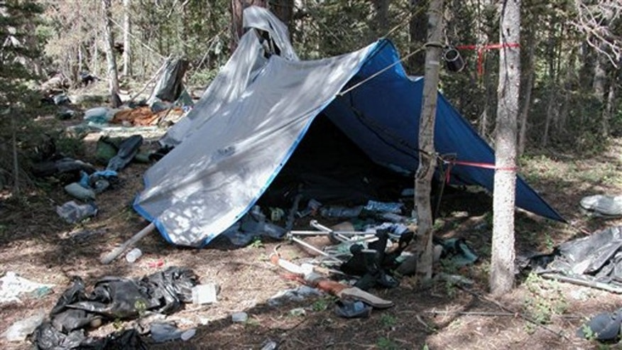 This undated photo provided by the Iron County Sheriff's Office shows , a remote camp littered with supplies and trash in the southern Utah wildness near Zion National Park. Authorities believe the camp was left behind by a suspect in more than two dozen burglaries of mountain cabins over an area of roughly 1,000 square miles for the past five years.