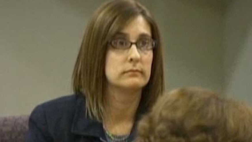 Feb. 21, 2012: Andrea Sneiderman testifies at the murder trial of her former boss, Hemy Neuman, who is accused of killing her husband.