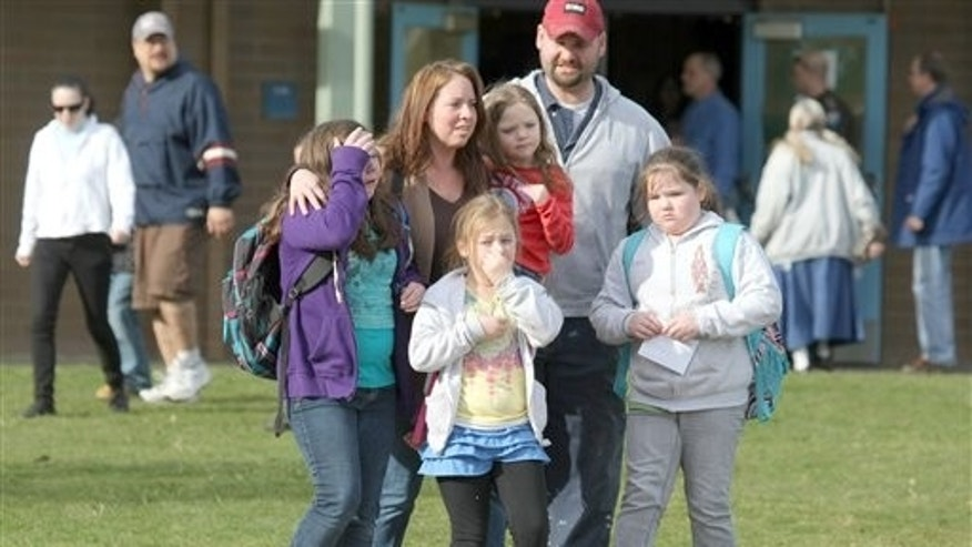 Feb. 22: Parents and children leave Armin Jahr Elementary School in Bremerton, Wash.