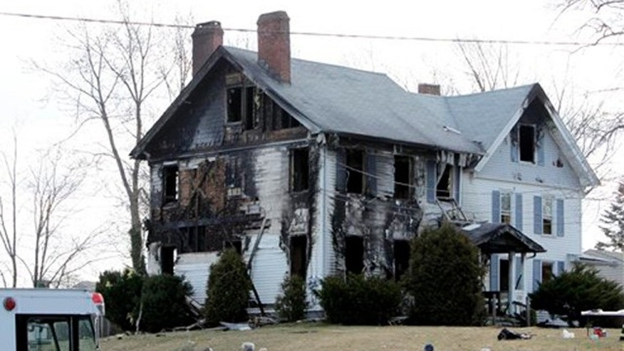 Feb. 23, 2012: Emergency personnel work around the scene of a fatal fire in South Plainfield, N.J.