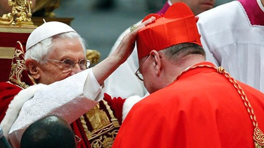 Feb. 18, 2012: Newly-elected Cardinal, Archbishop of New York Timothy Michael Dolan, of the U.S.A., receives his biretta hat from Pope Benedict XVI during his elevation inside St. Peter's Basilica at the Vatican.