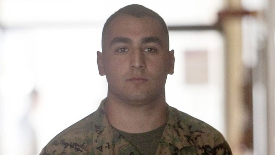In this file photo from Monday, Jan. 30, 2012, Lance Cpl. Carlos Orozco III walks to the courtroom of the Legal Services Center of Marine Corps Base Hawaii in Kaneohe Bay, Hawaii.