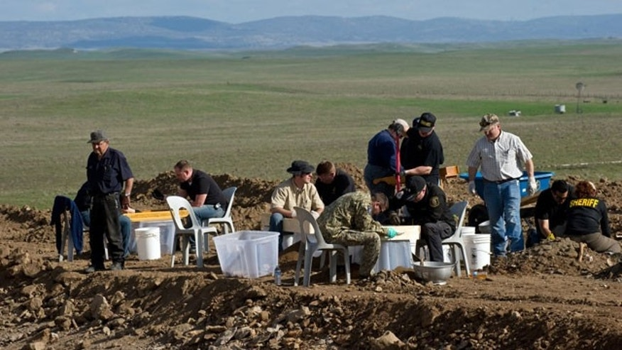 Feb. 12, 2012: San Joaquin Sheriff deputies and Department of Justice personnel sift for human remains that were excavated from an abandoned cattle ranch near Linden, Calif.