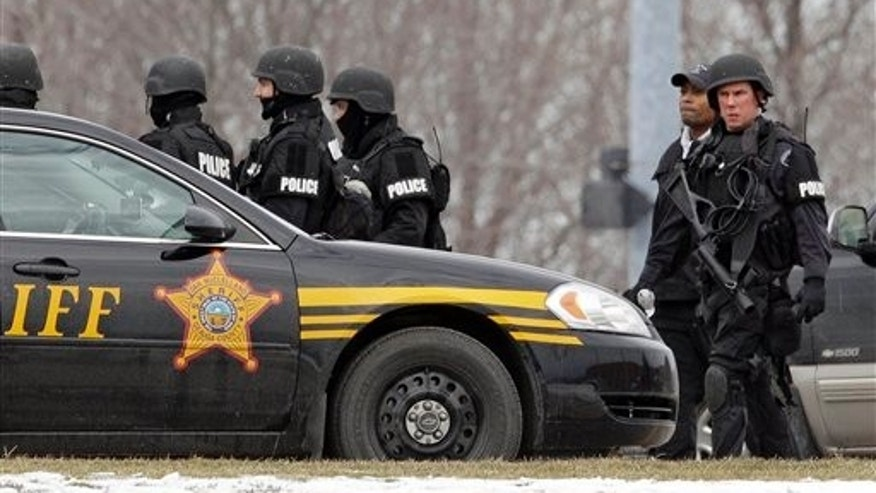 Feb. 27: S.W.A.T. members leave Chardon High School in Chardon, Ohio Monday. A gunman opened fire inside the high school's cafeteria at the start of the school day Monday, killing one student and wounding four others.