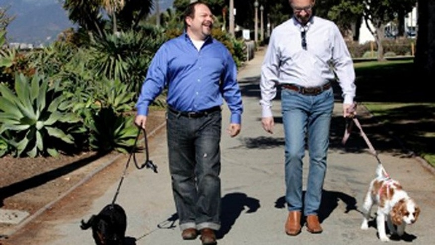 Feb. 23, 2012: This photo shows Steven May, right  walking with his dog, Winnie beside his attorney, David Pisarra, walking his dog, Dudley in Santa Monica, Calif.