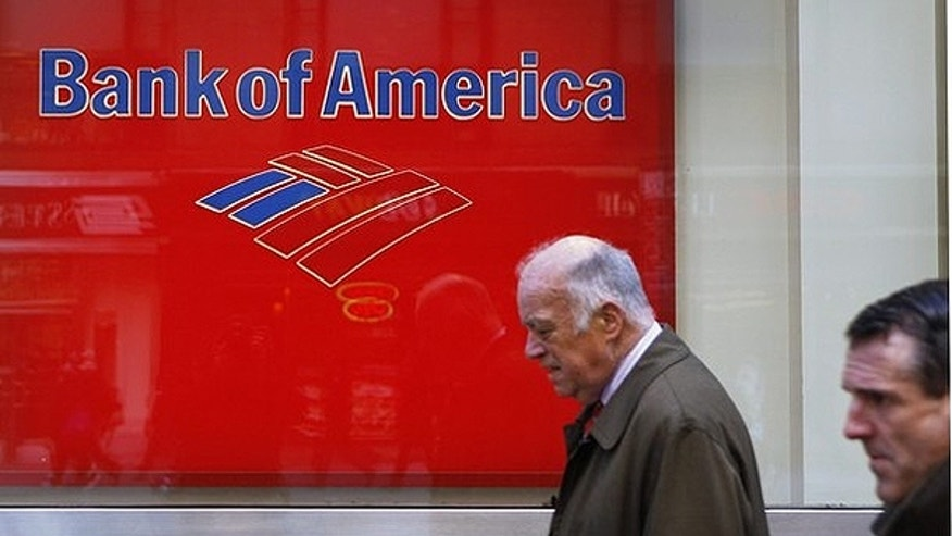 March 8: Pedestrians walk past a Bank of America sign on the street in New York.