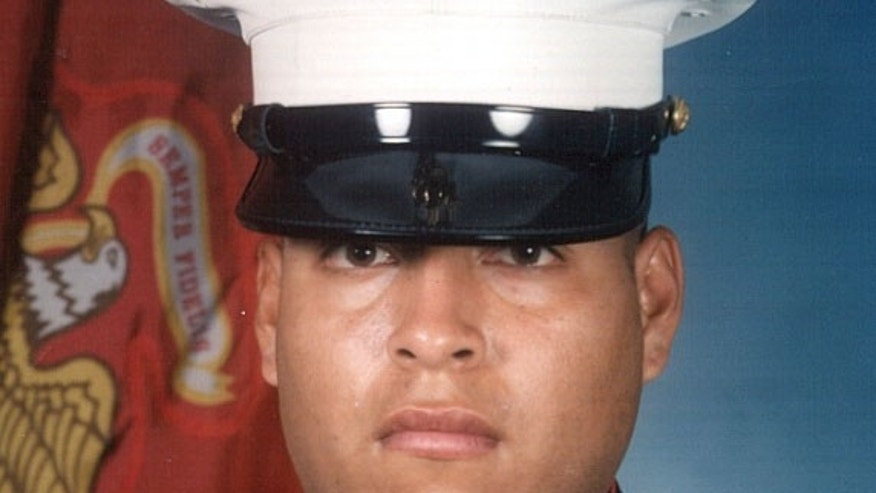 FILE - This undated photo released by the U.S. Marines, shows Sgt. Rafael Peralta, 25.