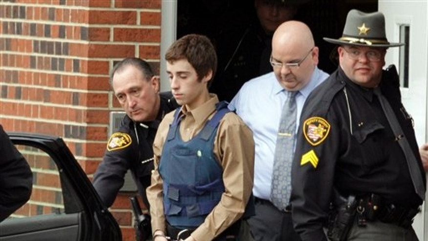 Feb. 28: T.J. Lane, 17, is led from Juvenile Court by Sheriff's deputies in Chardon, Ohio, after his arraignment in the shooting of five high school students Monday. Three of the five students wounded in the attacks have since died.
