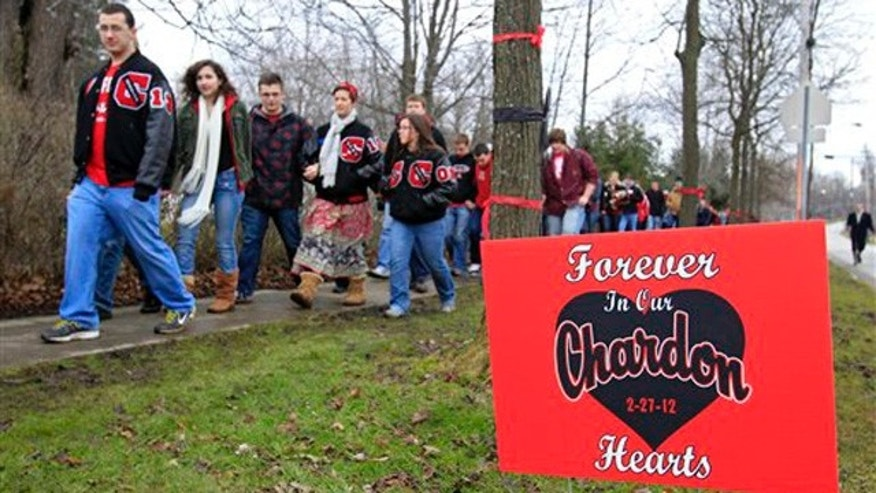 March 1, 2012: Students and parents march to Chardon High School in Chardon, Ohio, to honor the three students who were killed in a shooting there Monday.