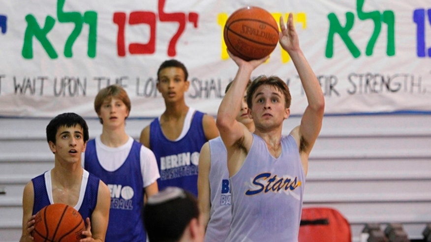 Feb. 28, 2012: Senior Isaac Mirwis, 18, shoots a 3-pointer during basketball practice at Beren Academy in Houston.