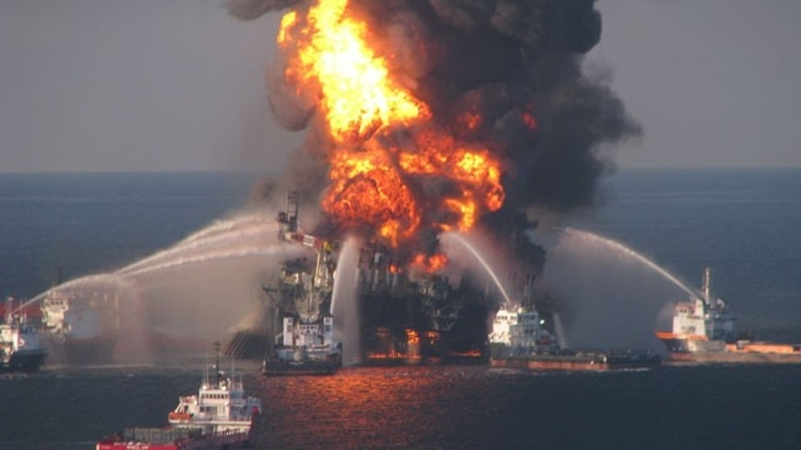 In this April 21, 2010 file photo provided by the U.S. Coast Guard, fire boat response crews spray water on the blazing remnants of BP's Deepwater Horizon offshore oil rig.